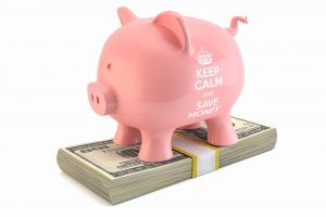 Photo showing a piggy bank with the text 'keep calm and save money'. A realtor will help you save money.